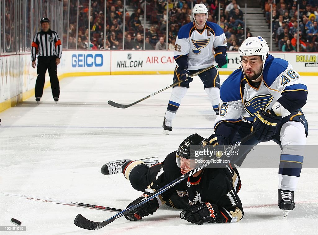 <a gi-track='captionPersonalityLinkClicked' href=/galleries/search?phrase=Roman+Polak&family=editorial&specificpeople=2109482 ng-click='$event.stopPropagation()'>Roman Polak</a> #46 of the St. Louis Blues lunges for the puck over <a gi-track='captionPersonalityLinkClicked' href=/galleries/search?phrase=Saku+Koivu&family=editorial&specificpeople=202253 ng-click='$event.stopPropagation()'>Saku Koivu</a> #11 of the Anaheim Ducks in front of teammate <a gi-track='captionPersonalityLinkClicked' href=/galleries/search?phrase=David+Backes&family=editorial&specificpeople=2538492 ng-click='$event.stopPropagation()'>David Backes</a> #42 on March 10, 2013 at Honda Center in Anaheim, California.