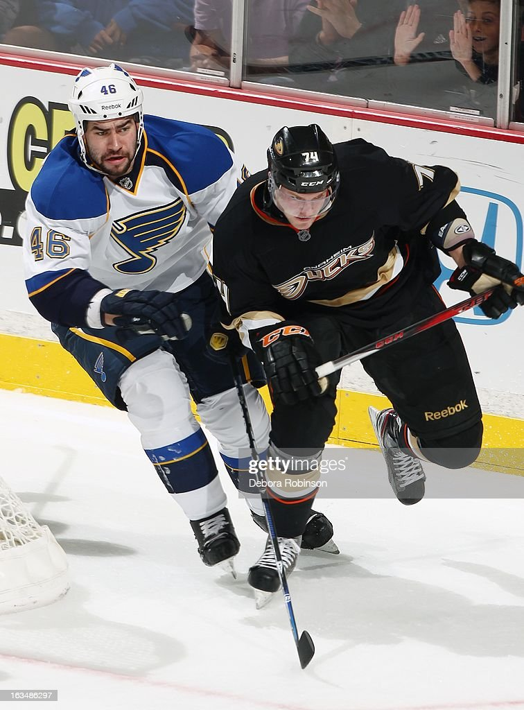 Roman Polak #46 of the St. Louis Blues works for position against Peter Holland #74 of the Anaheim Ducks on March 10, 2013 at Honda Center in Anaheim, California.