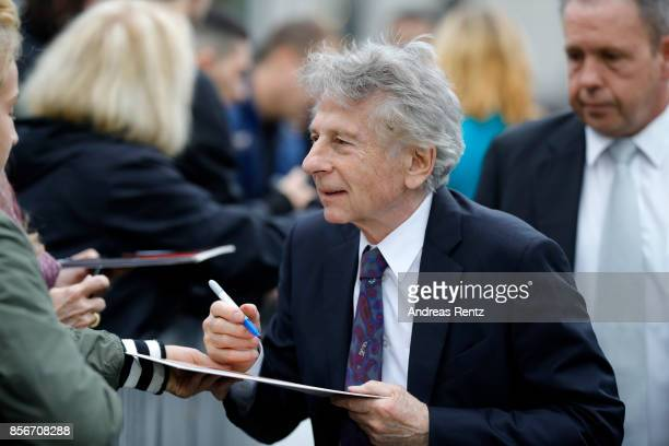Roman Polanski writes autographs as he attends the 'D'apres une histoire vraie' premiere at the 13th Zurich Film Festival on October 2 2017 in Zurich...