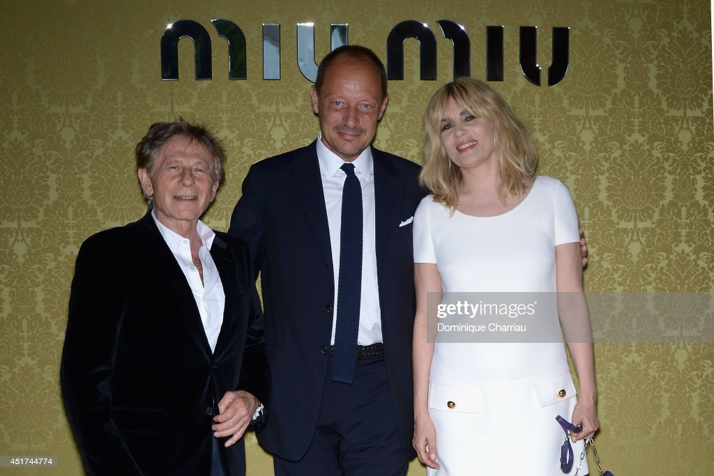 <a gi-track='captionPersonalityLinkClicked' href=/galleries/search?phrase=Roman+Polanski&family=editorial&specificpeople=207150 ng-click='$event.stopPropagation()'>Roman Polanski</a>,Stefano Cantino and <a gi-track='captionPersonalityLinkClicked' href=/galleries/search?phrase=Emmanuelle+Seigner&family=editorial&specificpeople=240590 ng-click='$event.stopPropagation()'>Emmanuelle Seigner</a> attend the Miu Miu Resort Collection 2015 at Palais d'Iena on July 5, 2014 in Paris, France.