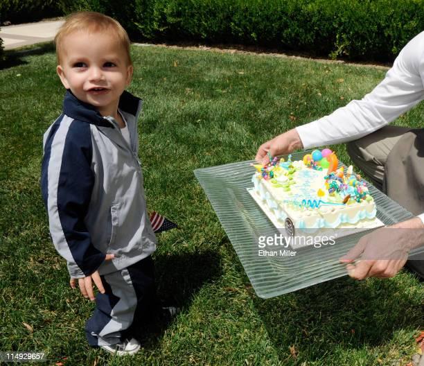 Roman Porrino son of television personality Angel Porrino checks out his birthday cake at a Memorial Day weekend pool party at Ravella at Lake Las...