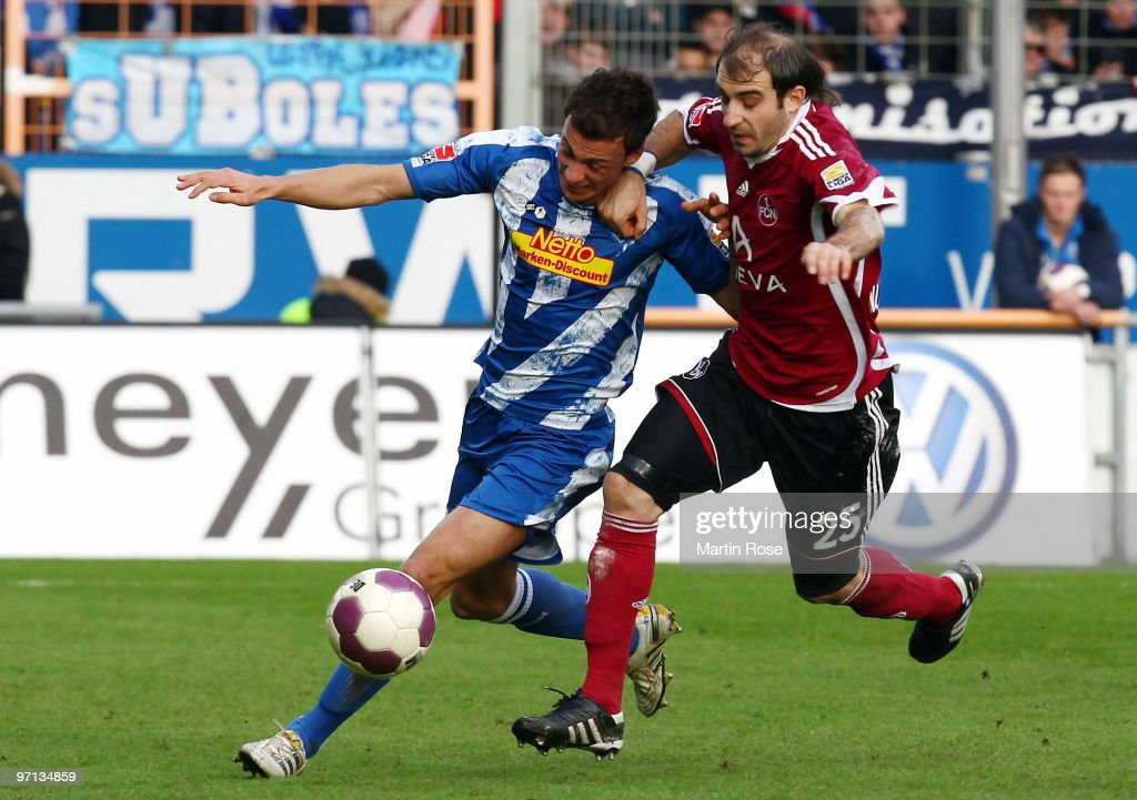 Roman Prokoph of Bochum and Javier Pinola of Nuernberg compete for the ball during the Bundesliga match between VFL Bochum and 1 FC Nuernberg at the...