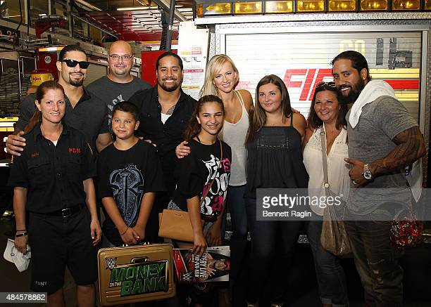 Roman Reigns Jey Uso Summer and Jimmy Uso pose for a picture with the family of Port Authority police officer Christopher Amoroso killed on 9/11...