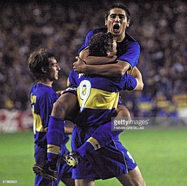 Roman Riquelme of Argentina's Boca Juniors soccer club celebrates his second goal against another Argentine team River Plate 24 May 2000 in their...