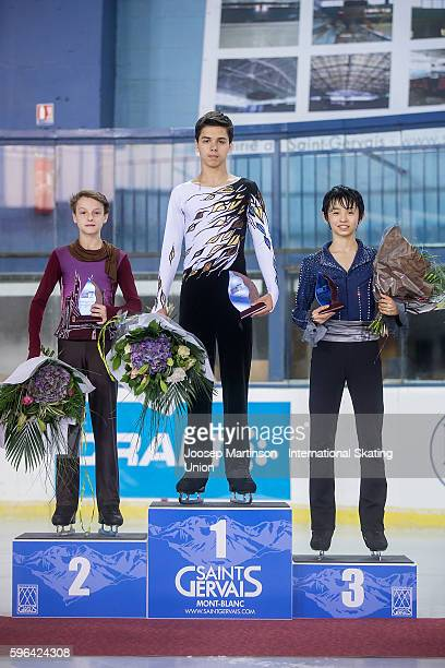 Roman Savosin Ilia Skirda of Russia and Koshiro Shimada of Japan pose during the junior men free skating medal ceremony on day three of the ISU...