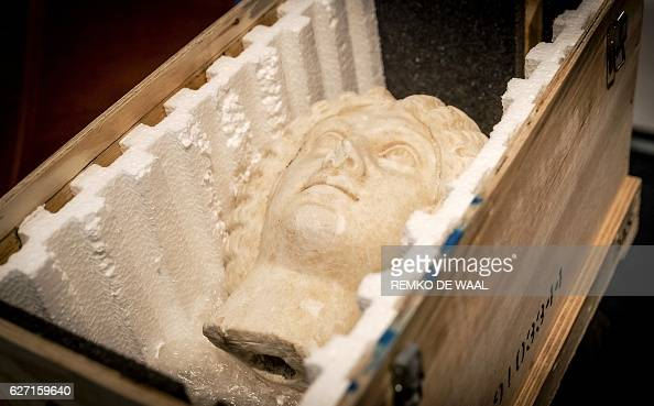 A Roman sculpture representing the head of Julia Domna Empress and wife of Roman Emperor Lucius Septimius Severus is pictured during its handover by...