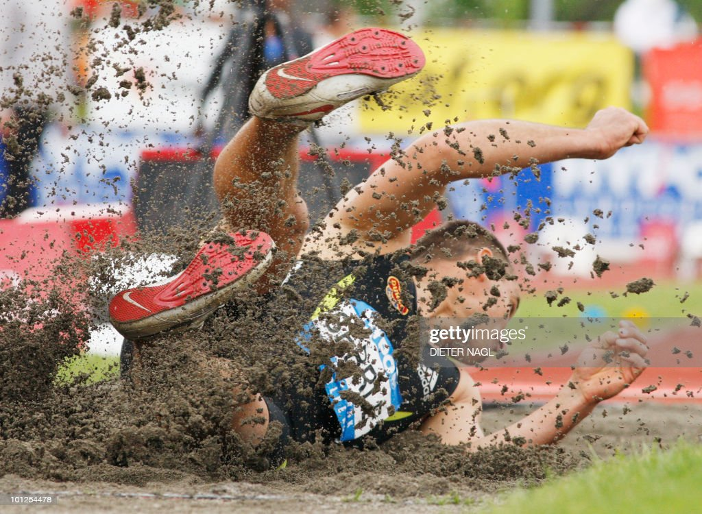 Roman Sebrle lands in the sand during the long jump event on the first day of the Men's decathlon meeting held in Goetzis, Austria on May 29, 2010 some 640 kilometers west of Vienna.