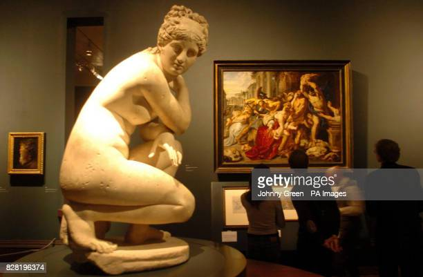 A Roman second century AD marble statue of 'Naked Venus Crouching at her Bath' sits in front of Rubens' 'The Massacre of the Innocents' and are on...
