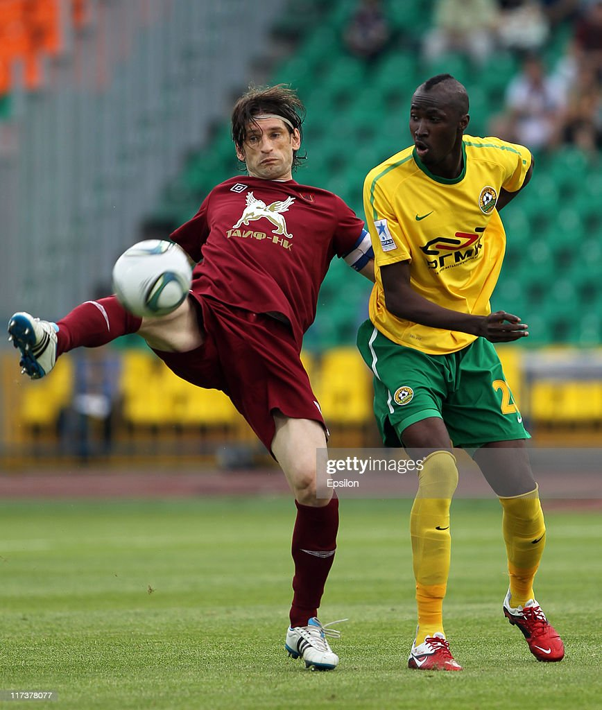 Roman Sharonov (L) of FC Rubin Kazan battles for the ball with <a gi-track='captionPersonalityLinkClicked' href=/galleries/search?phrase=Lacina+Traore&family=editorial&specificpeople=6515667 ng-click='$event.stopPropagation()'>Lacina Traore</a> of FC Kuban Krasnodar during the Russian Football League Championship match between FC Rubin Kazan and FC Kuban Krasnodar at the Tsentraliniy Stadium on June 26, 2011 in Kazan, Russia.