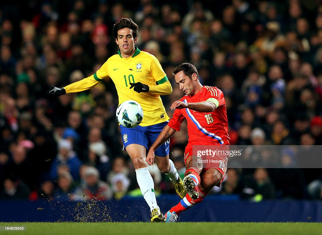 Roman Shirkov of Russia (R) in action with Kaka of Brazil during an International Friendly between Brazil and Russia at Stamford Bridge on March 25, 2013 in London, England.