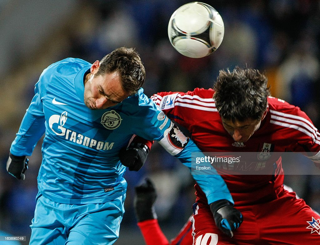 Roman Shirokov of FC Zenit St. Petersburg (L) and Evgeni Aldonin of FC Mordovia Saransk vie for a header during the Russian Football League Championship match between FC Zenit St. Petersburg and FC Mordovia Saransk at the Petrovsky Stadium on March 17, 2013 in St. Petersburg, Russia.