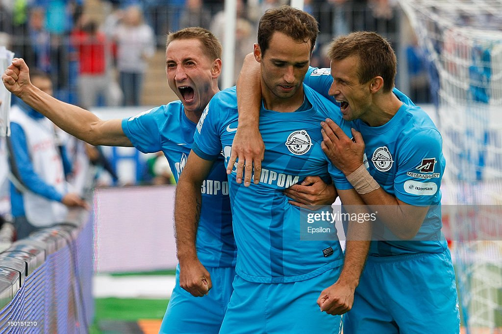 <a gi-track='captionPersonalityLinkClicked' href=/galleries/search?phrase=Roman+Shirokov&family=editorial&specificpeople=2348160 ng-click='$event.stopPropagation()'>Roman Shirokov</a> of FC Zenit St. Petersburg (C) celebrates his goal with <a gi-track='captionPersonalityLinkClicked' href=/galleries/search?phrase=Vladimir+Bystrov&family=editorial&specificpeople=2056444 ng-click='$event.stopPropagation()'>Vladimir Bystrov</a> (L) and <a gi-track='captionPersonalityLinkClicked' href=/galleries/search?phrase=Sergei+Semak&family=editorial&specificpeople=753800 ng-click='$event.stopPropagation()'>Sergei Semak</a> of FC Zenit St. Petersburg, during the Russian Premier League match between FC Zenit St. Petersburg and FC Spartak Moscow. at the Petrovsky Stadium on August 11, 2012 in St. Petersburg, Russia.