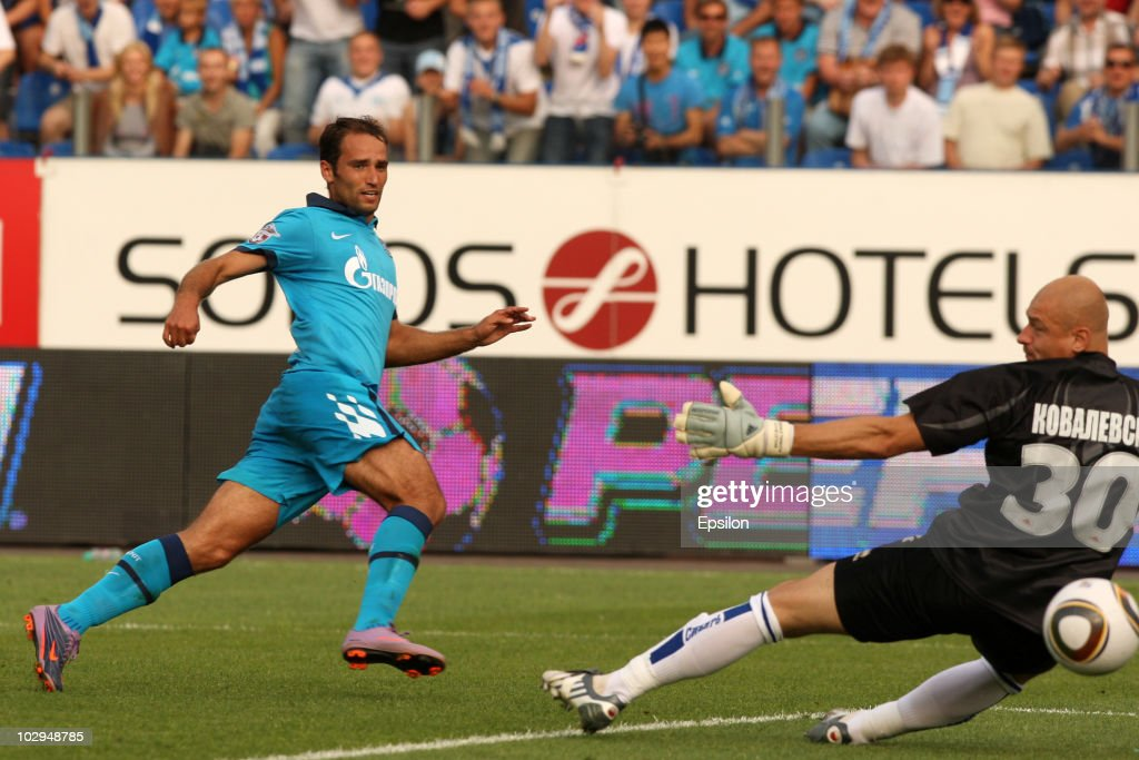 <a gi-track='captionPersonalityLinkClicked' href=/galleries/search?phrase=Roman+Shirokov&family=editorial&specificpeople=2348160 ng-click='$event.stopPropagation()'>Roman Shirokov</a> (L) of FC Zenit St. Petersburg scores a goal during the Russian Football League Championship match between FC Zenit St. Petersburg and FC Sibir Novosibirsk at the Petrovsky Stadium on July 04, 2010 in St. Petersburg, Russia.