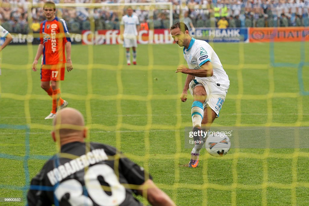 <a gi-track='captionPersonalityLinkClicked' href=/galleries/search?phrase=Roman+Shirokov&family=editorial&specificpeople=2348160 ng-click='$event.stopPropagation()'>Roman Shirokov</a> of FC Zenit St. Petersburg scores a goal during the Russian Cup final match between FC Zenit St. Petersburg and FC Sibir Novosibirsk at the Olimp-2 Stadium on May 16, 2010 in Rostov-on-Don, Russia.