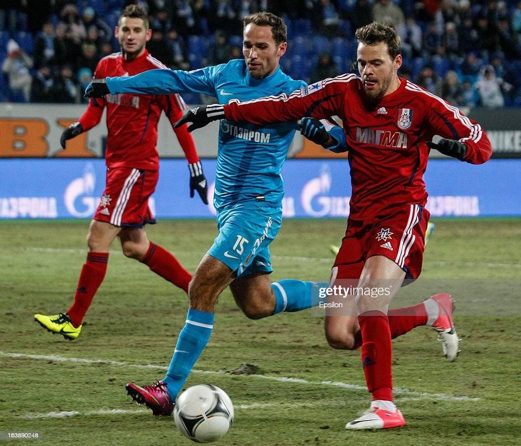 Roman Shirokov of FC Zenit St. Petersburg (C) vies for the ball with Milan Perendija (L) and Tomislav Dujmovic (R) of FC Mordovia Saransk during the Russian Football League Championship match between FC Zenit St. Petersburg and FC Mordovia Saransk at the Petrovsky Stadium on March 17, 2013 in St. Petersburg, Russia.