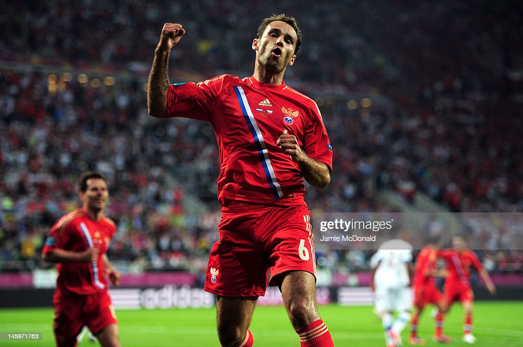 <a gi-track='captionPersonalityLinkClicked' href=/galleries/search?phrase=Roman+Shirokov&family=editorial&specificpeople=2348160 ng-click='$event.stopPropagation()'>Roman Shirokov</a> of Russia celebrates scoring their second goal during the UEFA EURO 2012 group A match between Russia and Czech Republic at The Municipal Stadium on June 8, 2012 in Wroclaw, Poland.
