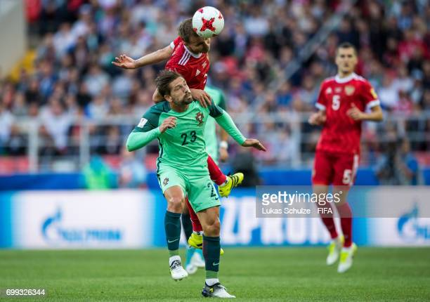 Roman Shishkin of Russia and Adrien Silva of Portugal fight for the ball during the FIFA Confederations Cup Russia 2017 Group A match between Russia...