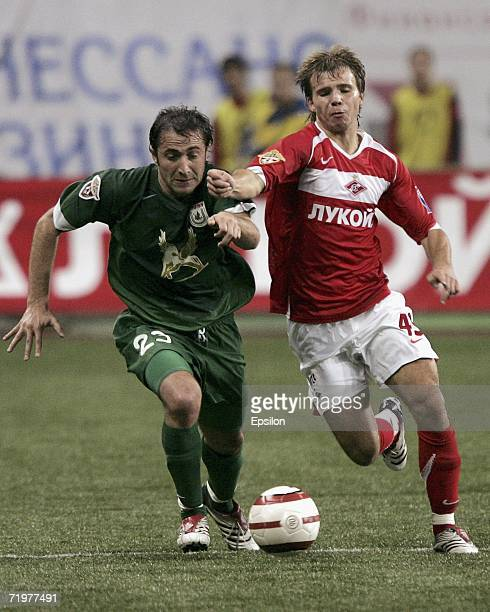Roman Shishkin of Spartak Moscow competes for the ball with Mikhail Ashvetia of Rubin Kazan during the Football Russian League Championship match...