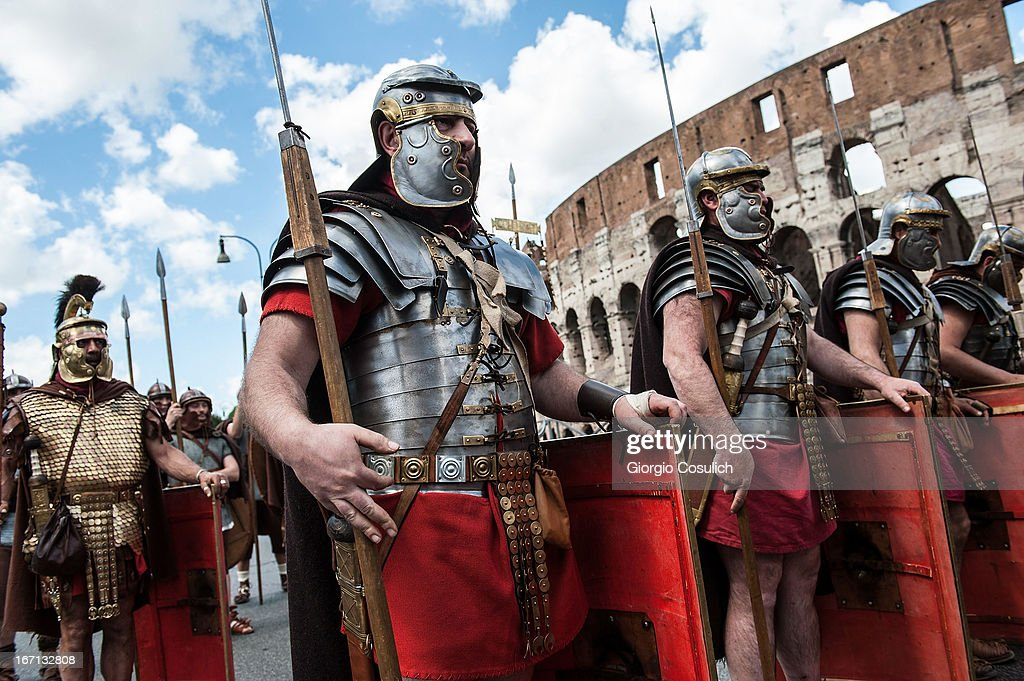 Roman soldiers march in front of the Coliseum in a commemorative parade during festivities marking the 2,766th anniversary of the founding of Rome on April 21, 2013 in Rome, Italy. The capital celebrates its founding annually based on the legendary foundation of the Birth of Rome. Actors dressed as the denizens of ancient Rome participate in parades and re-enactments of the ancient Roman Empire. According to legend, Rome had been founded by Romulus in 753 BC in an area surrounded by seven hills.