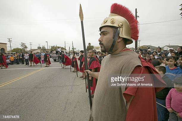 Roman Solider reenactors holding back crowd on Good Friday Easter during the Passion play a dramatic reenactment of the trial torture and death of...