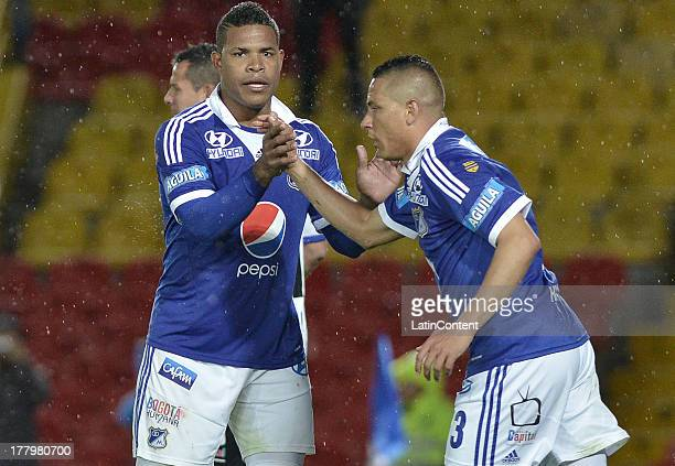 Roman Torres and Anderson Fernan Zapata of Millonarios shake hands during a match between Millonarios and Deportivo Pasto as part of the Liga...