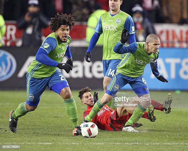 Roman Torres and Osvaldo Alonso of the Seattle Sounders break away against the Toronto FC during the 2016 MLS Cup at BMO Field on December 10 2016 in...