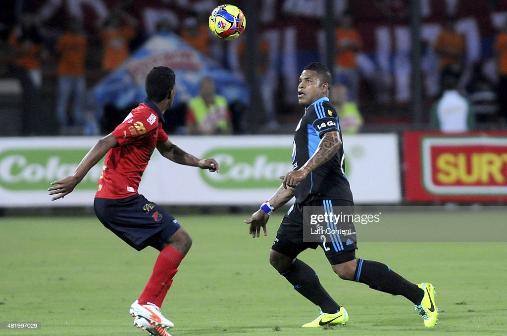 Roman Torres of Millonario (R) fights for the ball with a player of Medellin during a match between Medellin and Millonarios as part of the Liga Postobon 2014 at Atanasio Girardot Stadium on April 01, 2014 in Medellin Colombia.