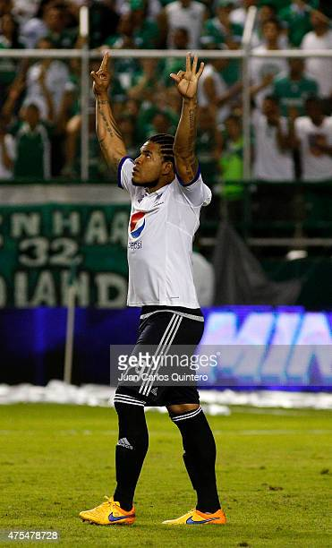 Roman Torres of Millonarios celebrates after scoring in the penalties series during a second leg match between Deportivo Cali and Millonarios as part...
