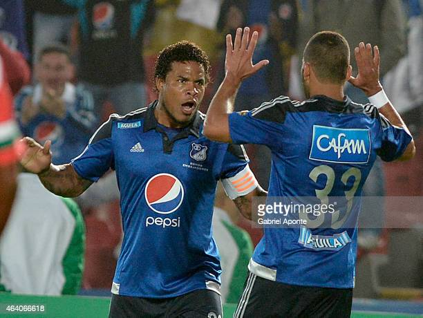 Roman Torres of Millonarios celebrates after scoring the first goal of his team during a match between Millonarios and Cortulua as part of fifth...