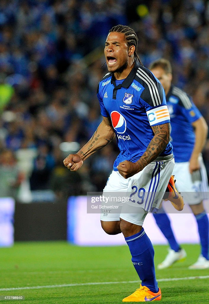 Roman Torres of Millonarios celebrates after scoring the first goal of his team against Medellin during a match between Millonarios and Medellin as part of 19th round of Liga Aguila I 2015 at Nemesio Camacho El Campin Stadium on May 09, 2015 in Bogota, Colombia.