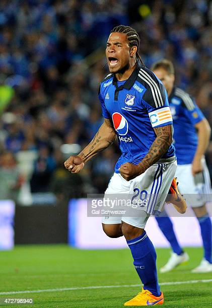 Roman Torres of Millonarios celebrates after scoring the first goal of his team against Medellin during a match between Millonarios and Medellin as...