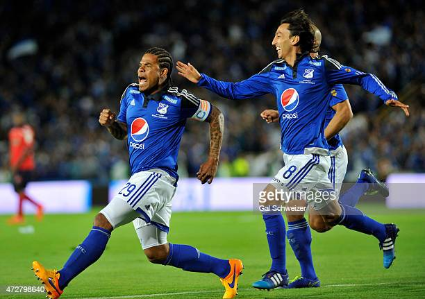 Roman Torres of Millonarios celebrates with teammate Rafael Robayo after scoring the first goal of his team against Medellin during a match between...