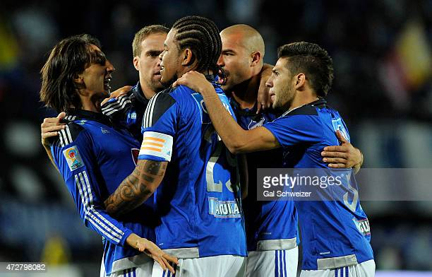 Roman Torres of Millonarios celebrates with teammates after scoring the first goal of his team against Medellin during a match between Millonarios...