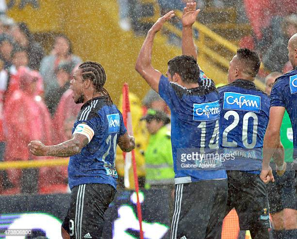 Roman Torres of Millonarios celebrates with teammates after scoring the second goal of his team during a match between Independiente Santa Fe and...