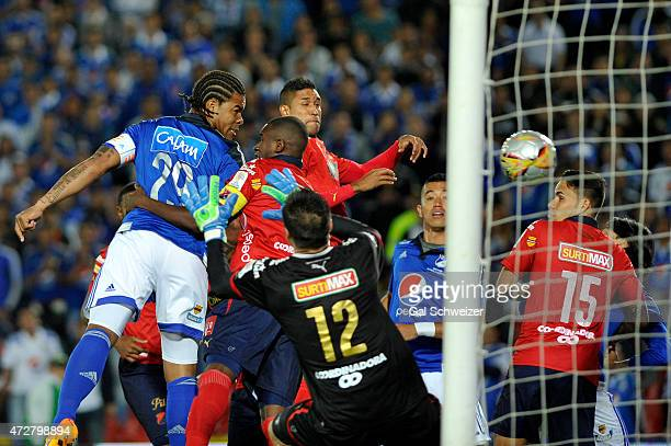 Roman Torres of Millonarios heads the ball to score the first goal of his team against Medellin during a match between Millonarios and Medellin as...