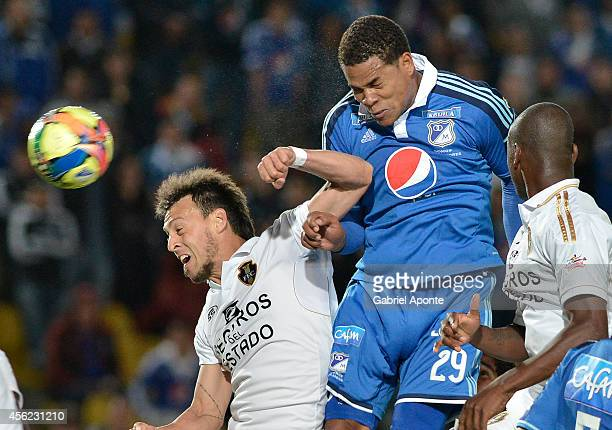 Roman Torres of Millonarios struggles for the ball with Victor Galain of Fortaleza during a match between Millonarios and Fortaleza as part of Liga...