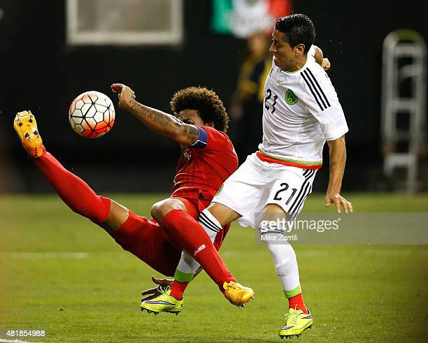 Roman Torres of Panama battles for the ball with Carlos Esquivel of Mexico during the 2015 CONCACAF Gold Cup semifinal match at Georgia Dome on July...