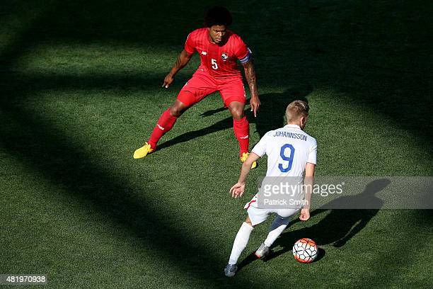 Roman Torres of Panama defends Aron Johannsson of the United States in the second half during the CONCACAF Gold Cup Third Place Match at PPL Park on...