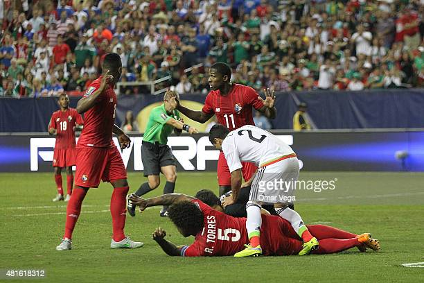 Roman Torres of Panama fights for the ball with Carlos Esquivel during a semi final match between Mexico and Panama as part of Gold Cup 2015 at...