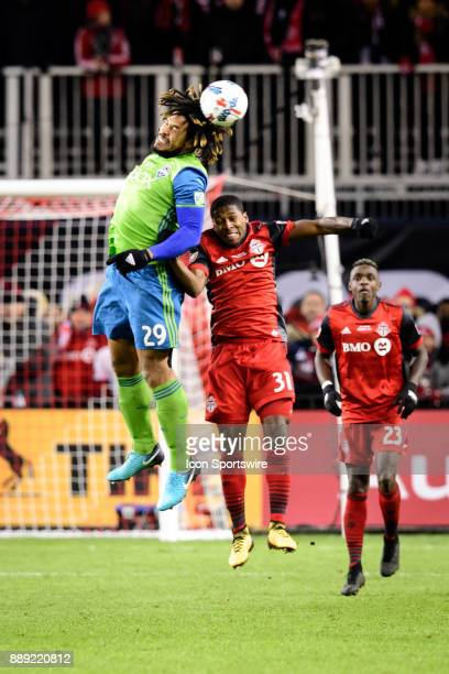 Roman Torres of Seattle Sounders FC and Armando Cooper of Toronto FC jump for the ball during the second half of the 2017 MLS Cup Final between...