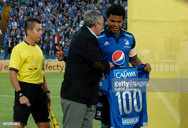 Roman Torres receives from Millonarios's CEO the number 100 shirt during a match between Millonarios and Cortulua as part of fifth round of Liga...