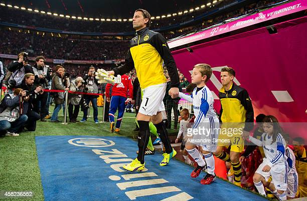 Roman Weidenfeller and Erik Durm enter the pitch before the Bundesliga match between Borussia Dortmund and FC Bayern Muenchen at Allianz Arena on...