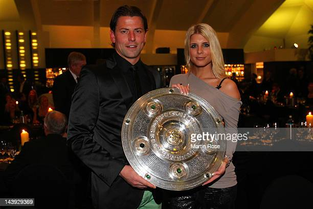 Roman Weidenfeller and his girlfriend Lisa pose with the trophy at View restaurant on May 5 2012 in Dortmund Germany
