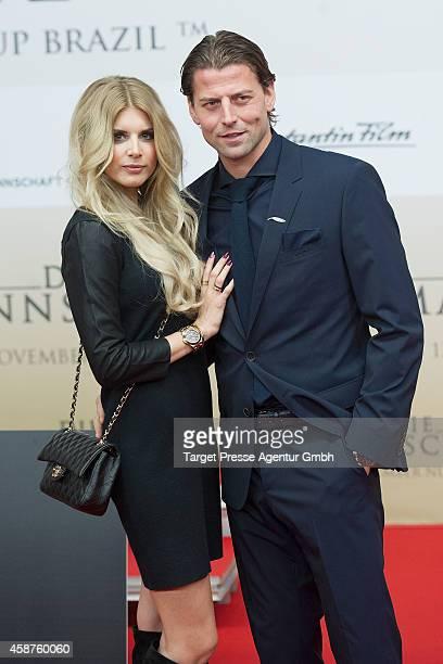 Roman Weidenfeller and Lisa Rossenbach attend the 'Die Mannschaft' premiere at Potsdamer Platz on November 10 2014 in Berlin Germany