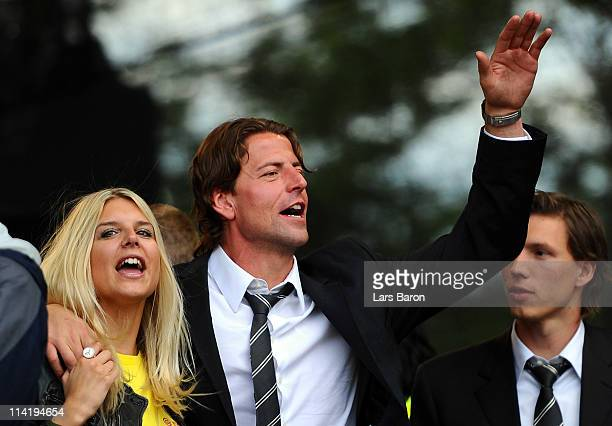 Roman Weidenfeller celebrates with girlfriend Lisa during the Borussia Dortmund Bundesliga winners parade at Westfalenhalle on May 15 2011 in...