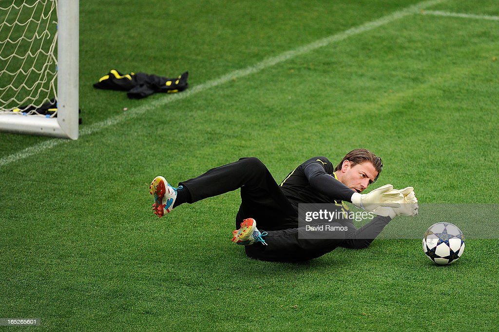 Roman Weidenfeller, goal keeper of Borussia Dortmund, saves the ball during training session ahead of the UEFA Champions League quarter-final first leg match against Malaga CF, at La Rosaleda Stadium on April 2, 2013 in Malaga, Spain.