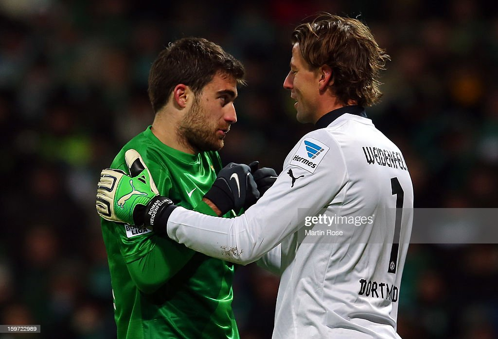 <a gi-track='captionPersonalityLinkClicked' href=/galleries/search?phrase=Roman+Weidenfeller&family=editorial&specificpeople=726753 ng-click='$event.stopPropagation()'>Roman Weidenfeller</a> (R), goalkeeper of Dortmund comforts Sokratis of Bremen during the Bundesliga match between Werder Bremen and Borussia Dortmund at Weser Stadium on January 19, 2013 in Bremen, Germany.