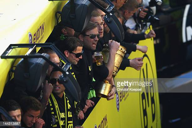 Roman Weidenfeller head coach Juergen Klopp and Florian Kringe celebrate with the DFB cup during a parade at Borsigplatz celebrating Borussia...