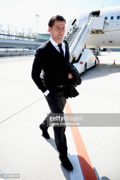 Roman Weidenfeller heads towards the team bus during the Borussia Dortmund arrival at Dortmund Airport on May 1 2013 in Dortmund Germany