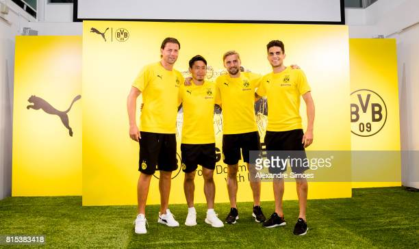Roman Weidenfeller Marc Bartra Shinji Kagawa and Marcel Schmelzer of Borussia Dortmund together during the KAMO activity event at the PUMA Brand...